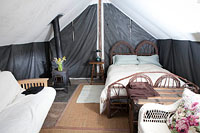 Farm stay deluxe furnished wall tent interior
