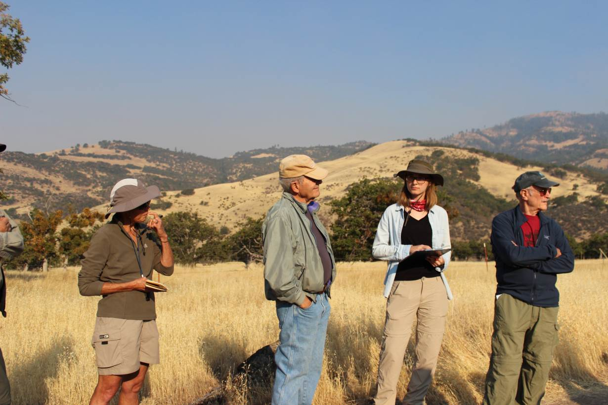 Residents of southern Oregon listen to a field lecture by a local geologist organized by the Friends of the Cascade-Siskiyou National Monument